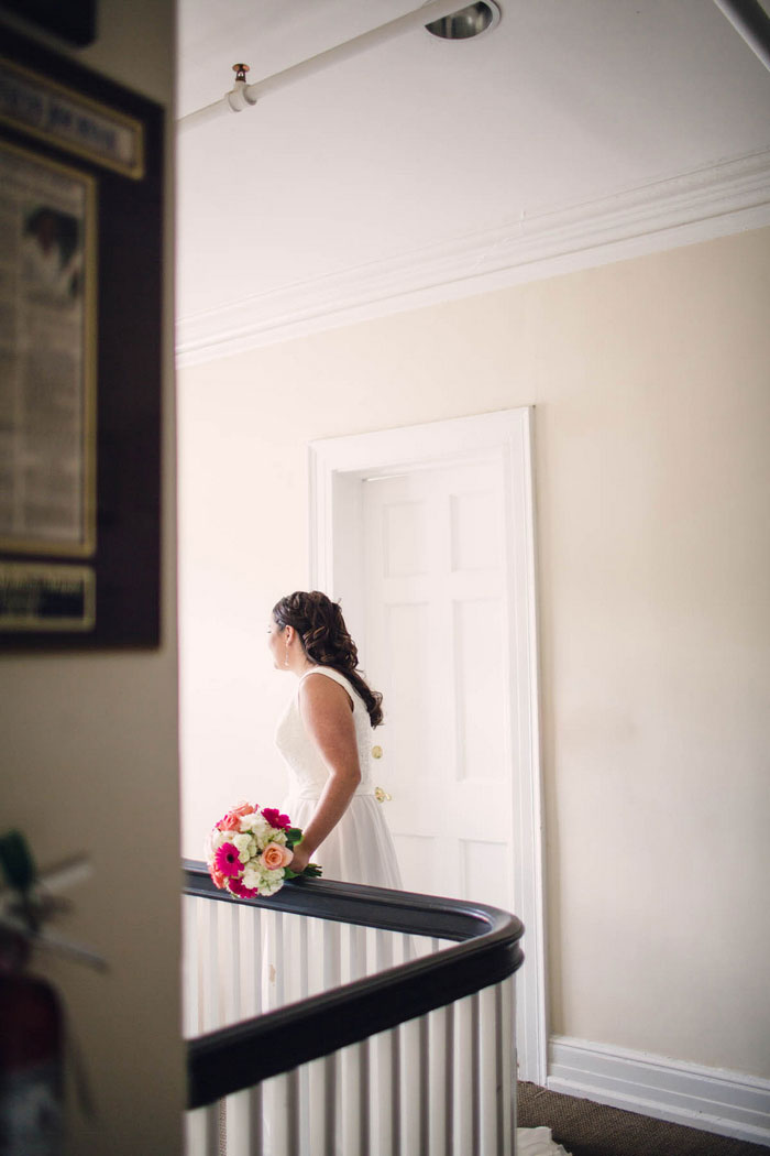 bride at the top of the staircase