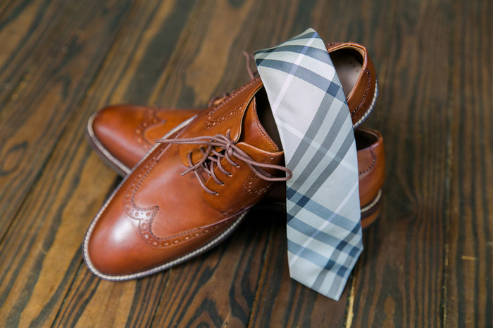 plaid tie and leather dress shoes
