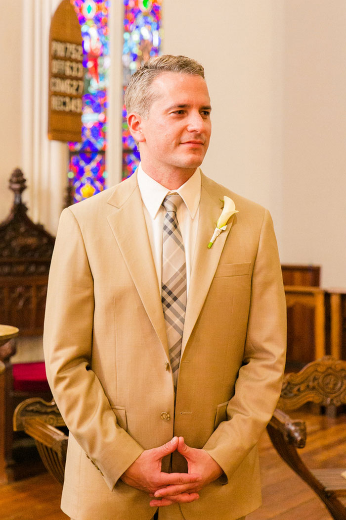 groom waiting at the altar