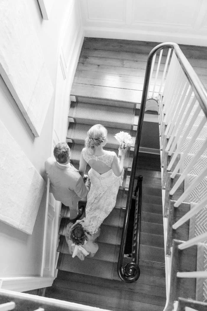 bird's eye view of bride and groom walking up stairs