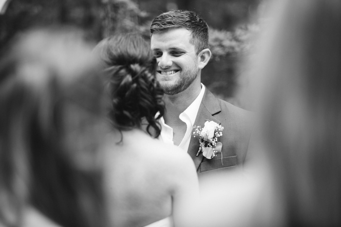 groom grinning during ceremony