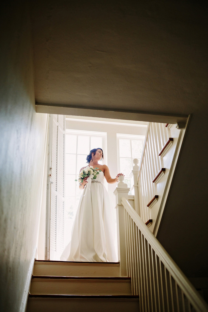 bride portrait at the top of the stairs