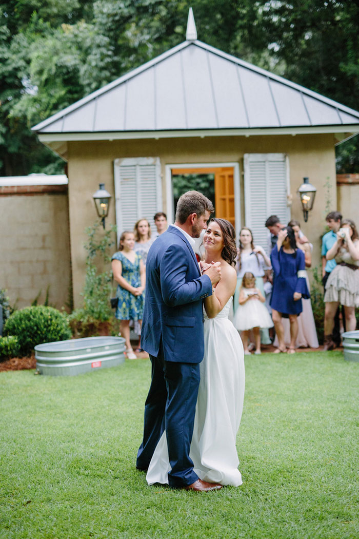 bride and groom dancing in backyard