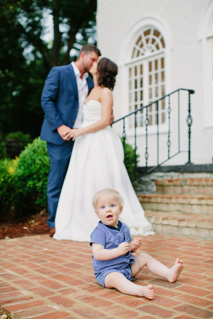 bride and groom portrait with baby