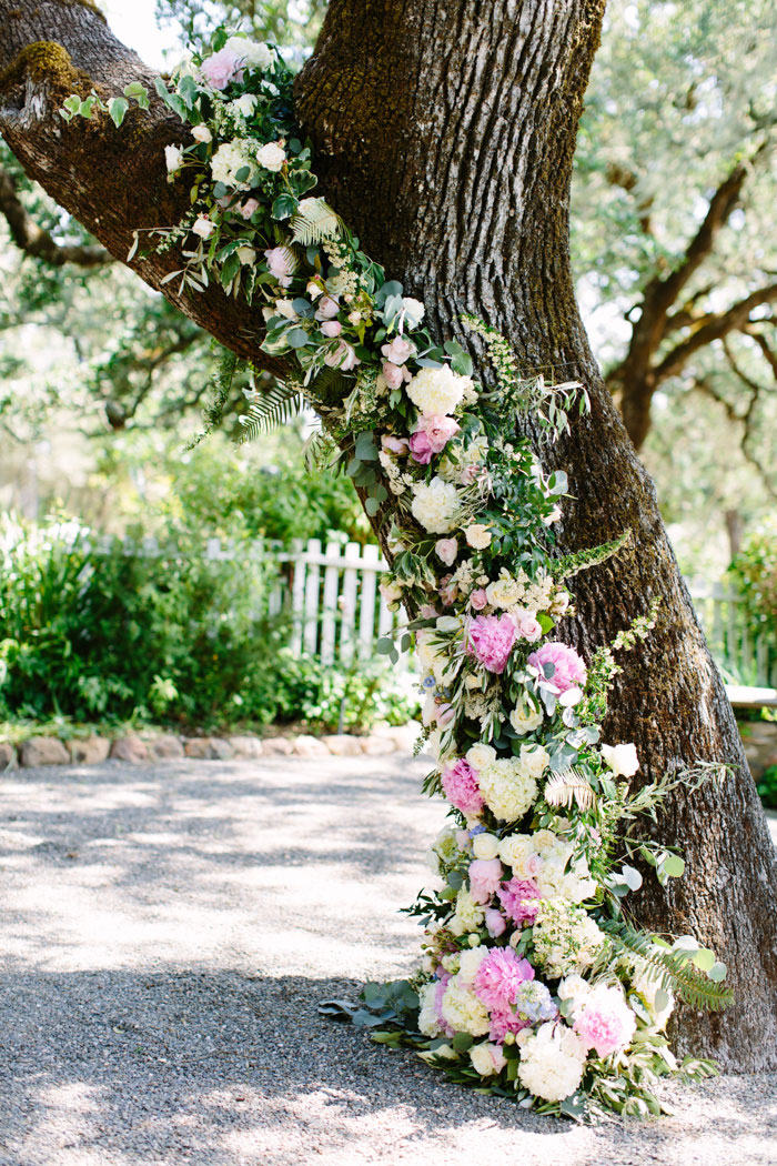 tree covered in wedding flowers