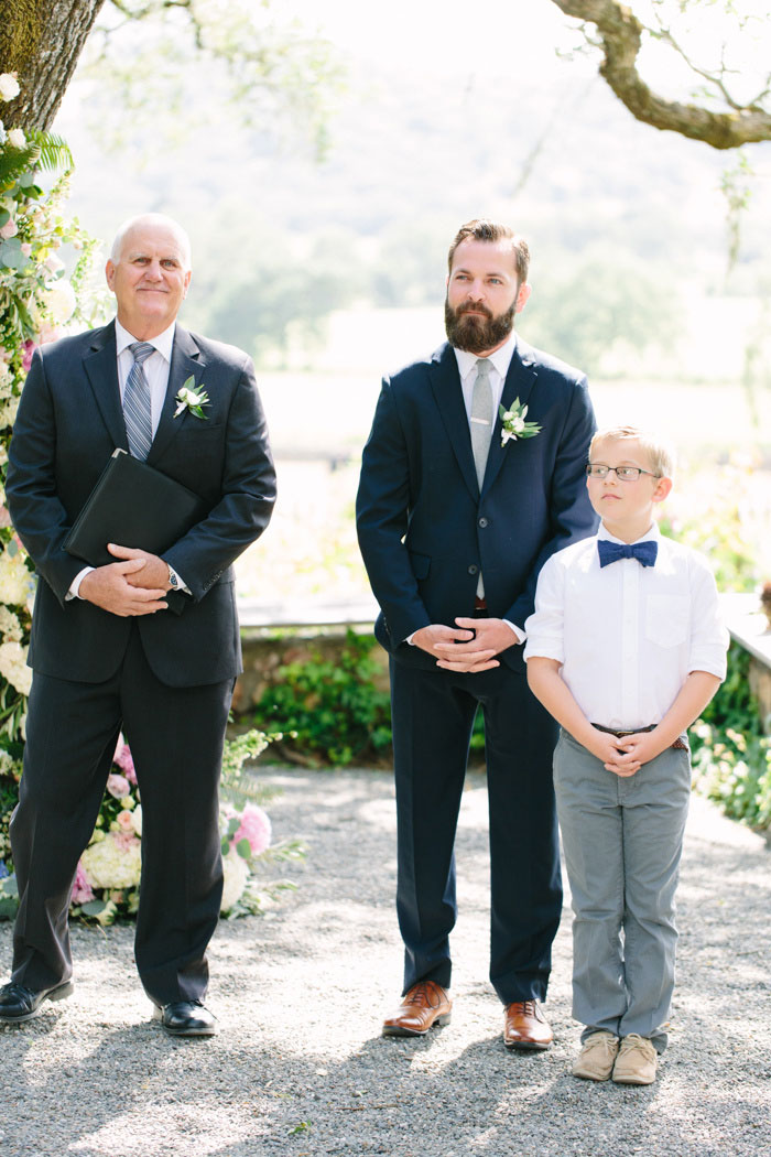 groom and son waiting at the altar