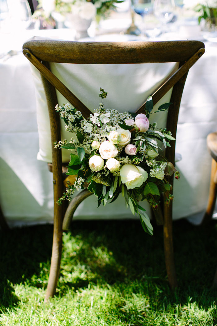 flowers on back of bride's chair