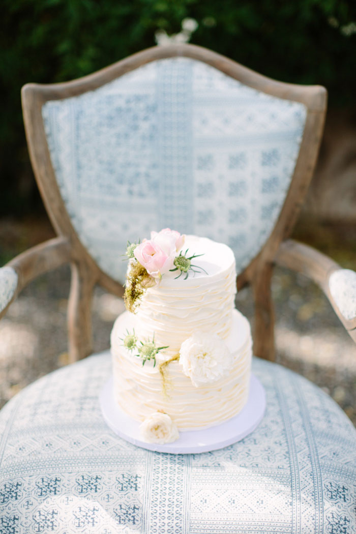 tiered wedding cake on chair