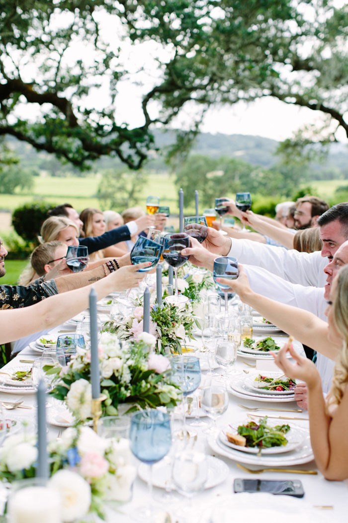 wedding guests raising glasses