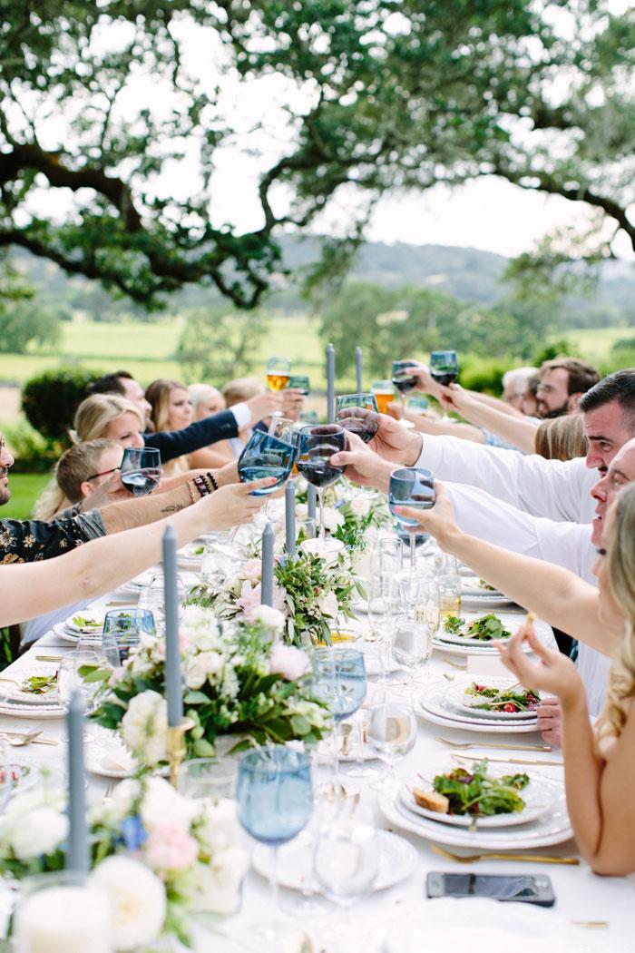 wedding guests raising glasses