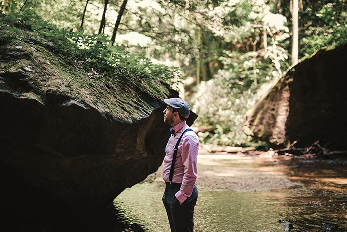 groom waiting by waterfall
