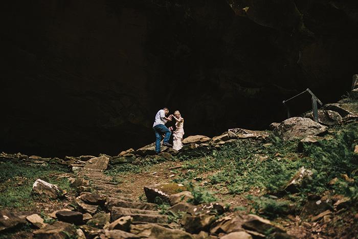 bride being helped down steep path