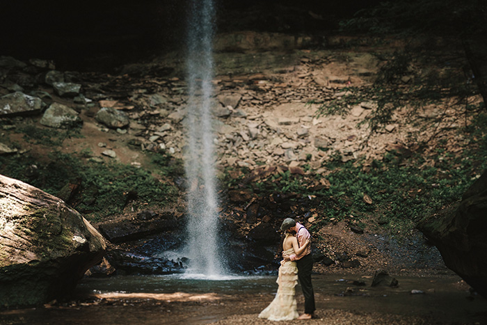 bride and groom portrait by waterfall