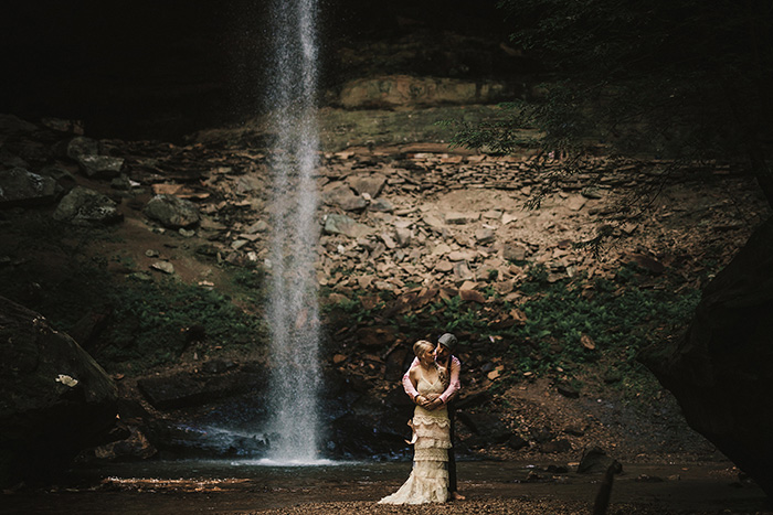 wedding portrait by waterfall
