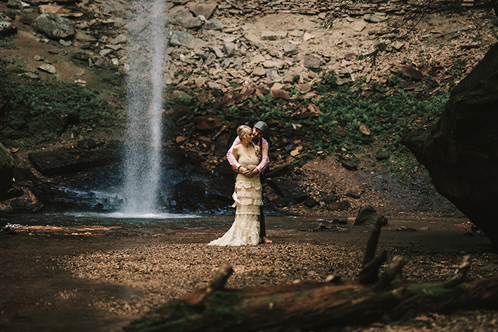 wedding portrait in front of waterfall