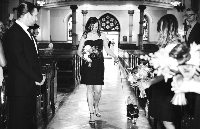 bridesmaid walking down the aisle with dog