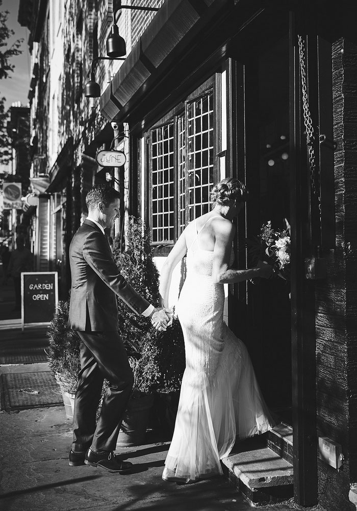 bride and groom entering restaurant