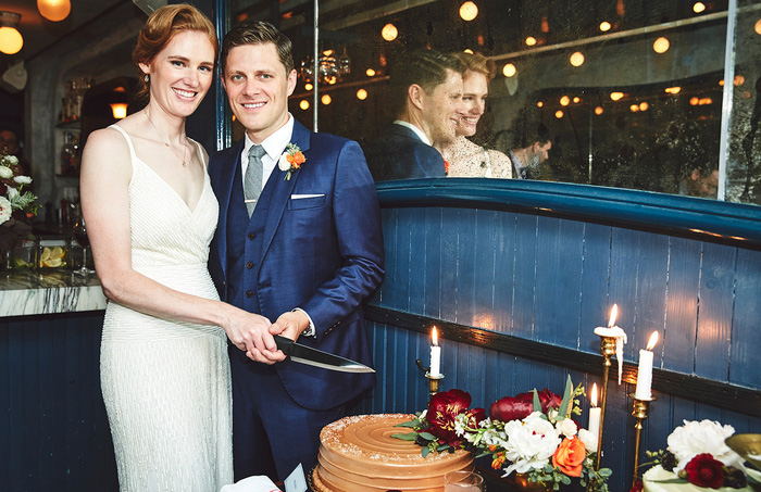 bride and groom about to cut cake