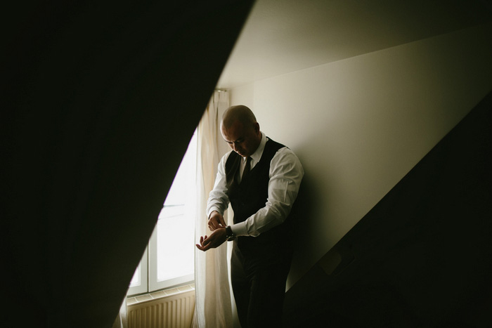 groom adjusting cuffs