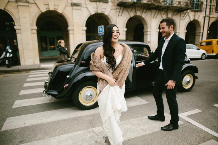 bride wearing fur stole crossing street