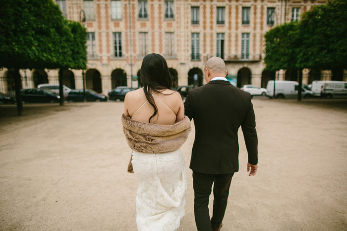 bride and groom walking through Paris