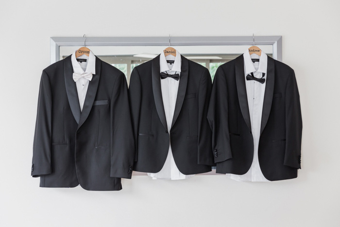 groomsmen's tuxedos hanging up