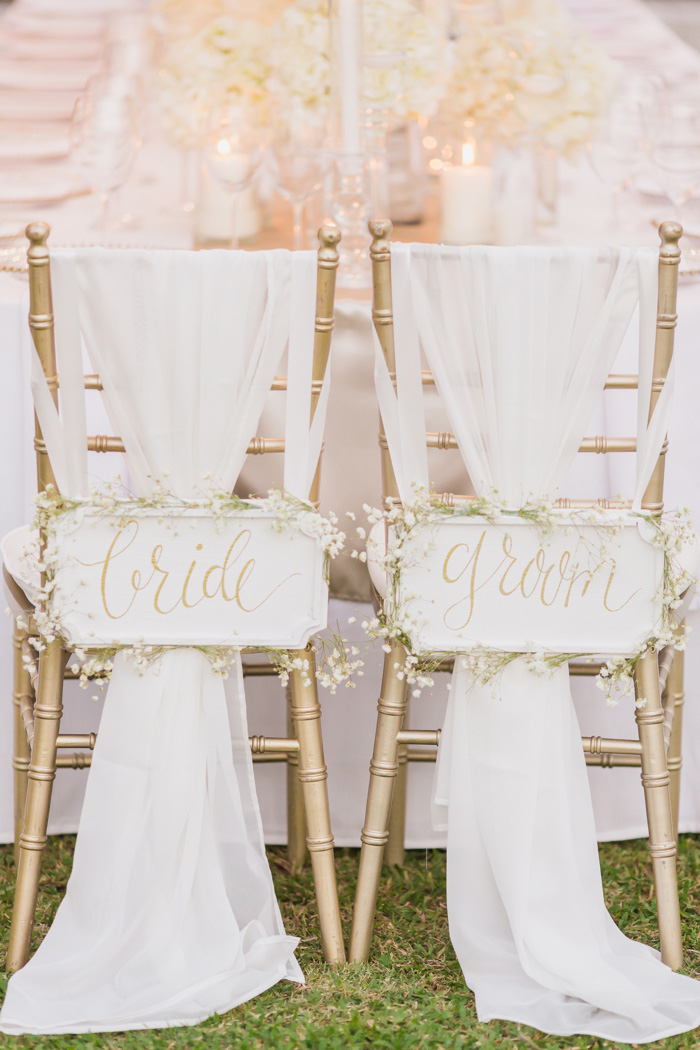 bride and groom signs on back of chairs