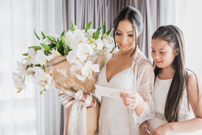 bride and daughter reading note from groom
