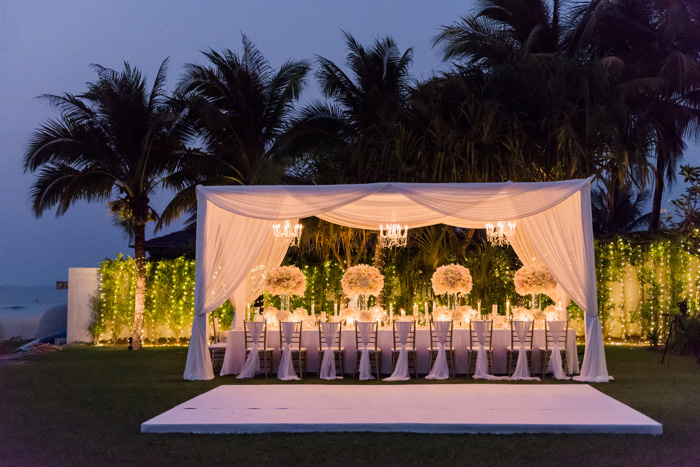 outdoor wedding reception dinner at night