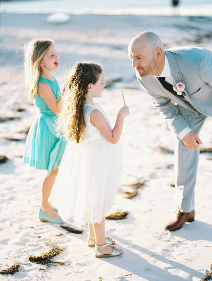 groom on the beach with step daughter