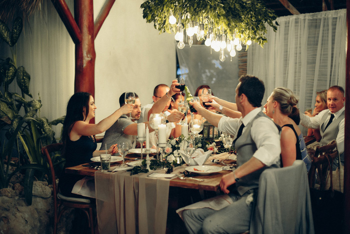 wedding guests raising their glasses