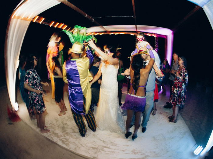 wedding guests dancing on the beach