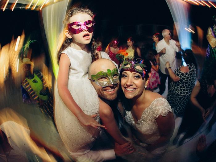 bride, groom, ad daughter at wedding reception