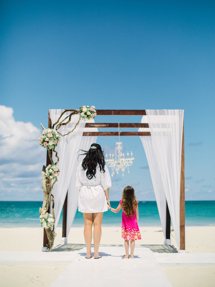 bride and daughter standing in front of altar before ceremony