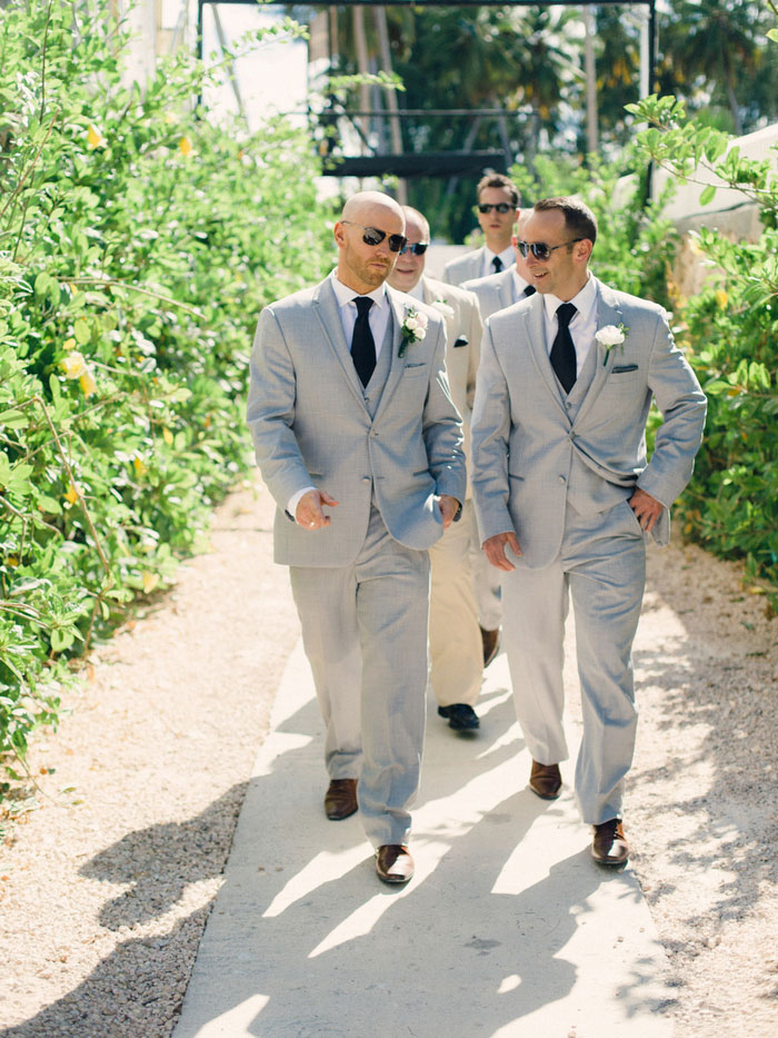 groomsmen walking to the beach
