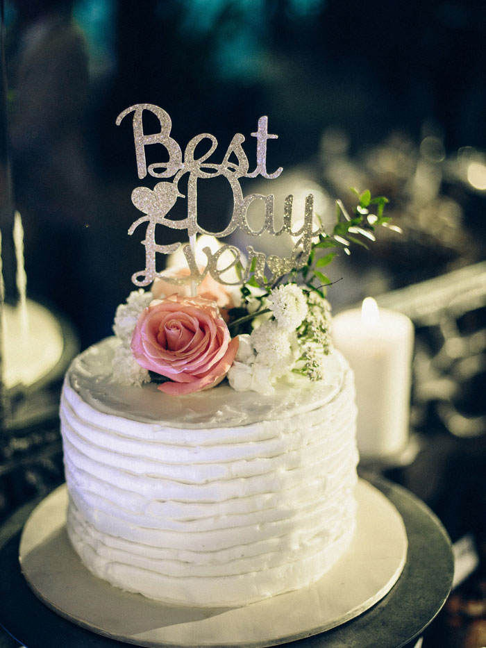 wedding cake with Best Day Ever topper
