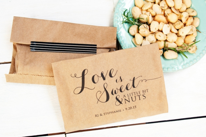 12 awesome edible wedding favors intimate weddings small wedding these cute love is nuts favor bags are from mavora you can fill them with some gourmet diy candied cashews walnuts or pecans solutioingenieria Image collections