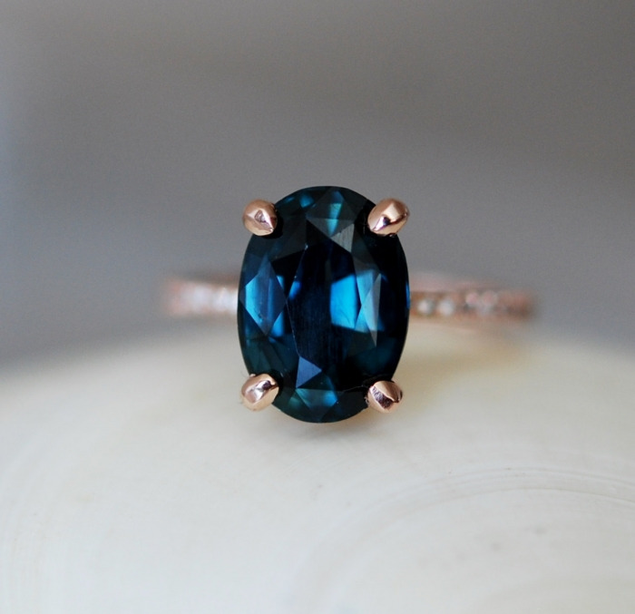 http://www.intimateweddings.com/wp-content/uploads/2017/04/peackock-blue-engagement-ring-etsy-700x677.jpeg