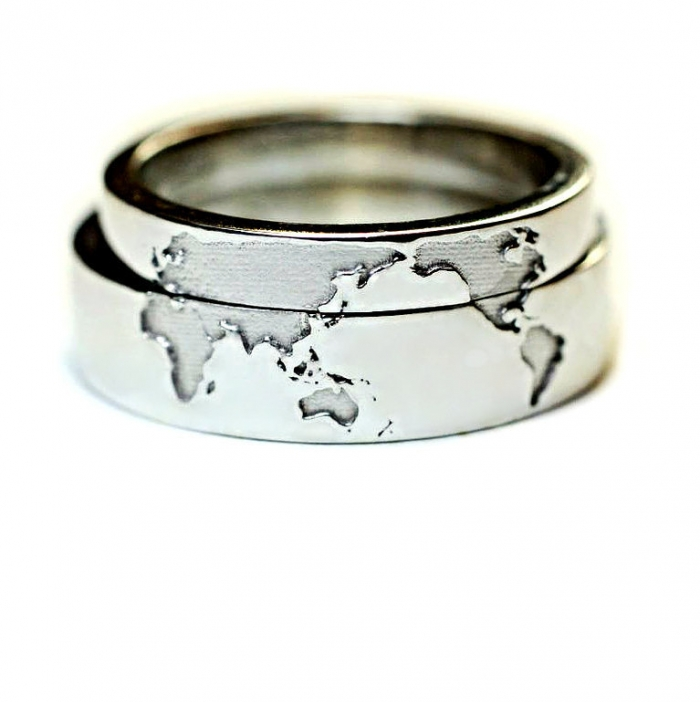 Unique wedding rings for the unique couple intimate weddings a world map made out of 14k gold on a wedding band if you love to travel this travelers wedding band from jewelryescorial is a dream come true junglespirit Gallery