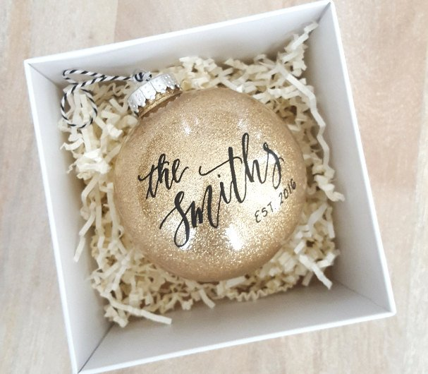 Celebrate your first Christmas together with this sparkly personalized  ornament from TheLetteringStudio . - 8 Holiday Ornaments For Newlyweds From Etsy Intimate Weddings